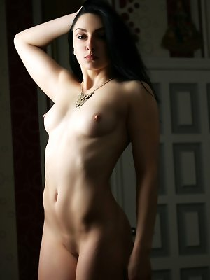 Sultry Diula performs an erotic strip tease baring her sexy physique and erect nipples in front of the camera.